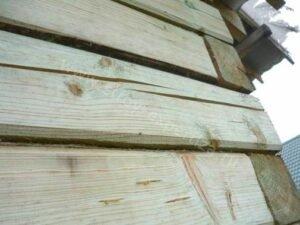 Обследование стен деревянного дома